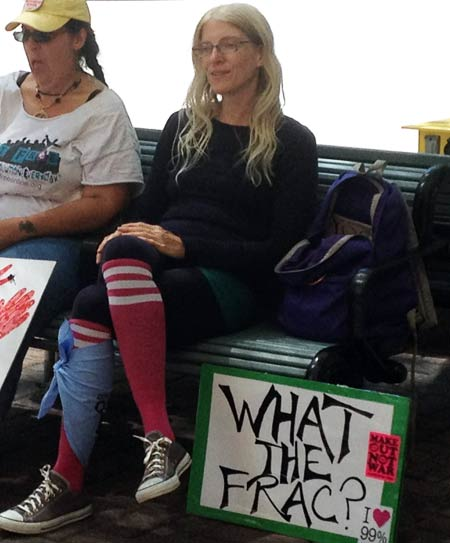 Protesters take a seat during Sunday's March on Wall Street South