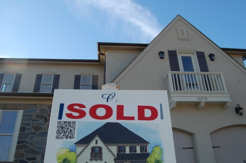 A sold sign sits this week in front of a home in Classica Homes' Robbins Park, a high-end development in Cornelius. Photo by Tony Brown.
