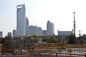 Summit at Church, above, is one of several large apartment projects that have contributed to the increase in the number and value of construction permits pulled in Mecklenburg County. Photo by Nell Redmond