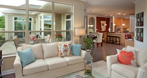 The interior of a typical Epcon Communities courtyard home shows the patio, through the window, that is built into the side of each house. Photo courtesy of Epcon Communities