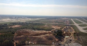 The Charlotte REgional Intermodal Facility, shown under construction in 2012 between two runways at Charlotte Douglas International Airport, is starting to attract distribution centers to the city's southwest commercial market. Photo courtesy charmeck.org