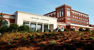 The Queens University Levine Center, left, and the South Residence Hall/garage, right, have been the subjects of legal actions brought by the school's neighbors in Myers Park. File photo by Nell Richmond