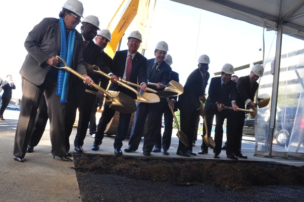 Local elected officials and Gov. Pat McCrory, fourth from left, join officials from development partners and anchor tenant Babson Capital in breaking ground on 300 South Tryon, the first high-rise to start construction since the recession. Photo by Eric Dinkins