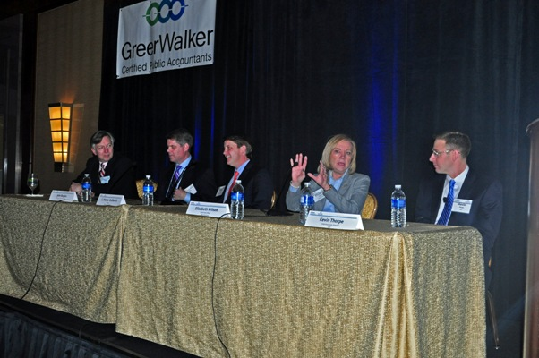 A panel of four industry professionals discussed the coming year's real estate outlook at the Ritz-Carlton, Charlotte on Monday night. From left to right are Daniel Huffenus with Katten Muchin Rosenman LLP; John Boylan, president of Spectrum Properties Carolinas; C. Walker Collier III, partner at Trinity Capital Advisors; and Elizabeth Wilson, chief credit officer at Fifth Third Bank.