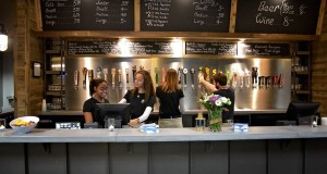 The recently installed bar offers a wide assortment of beers on tap. Drink rails and seating at the front of the lobby provide a comfortable spot to meet friends.