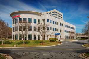 Trinity Partners will continue leasing and managing Three Executive Park, in SouthPark, after selling the building to an affiliate of Origin Capital Partners. Photo courtesy Trinity Partners