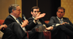 Phil Payne, CEO of Ginkgo Residential, speaks at the fifth annual Bisnow State of the Market breakfast in Charlotte. To his left are Steve McClure, president of Spectrum | Residential Inc., and Toby Bartlett, senior vice president at J.E. Dunn Construction Group Inc. Photo by Eric Dinkins