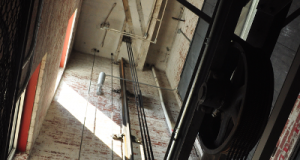 A 76-year-old elevator in the Dyestuff Commercial Lofts building was converted into a small lobby, and the elevator shaft remains intact. Photo by Eric Dinkins