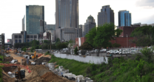 Construction on the Lynx Blue Line extension, seen from East 11th Street, will lengthen the light rail 9.3 miles northeast of center city, starting at East Ninth Street in uptown and ending at UNC Charlotte's campus. The extension is expected to start running in summer 2017. Photo by Eric Dinkins