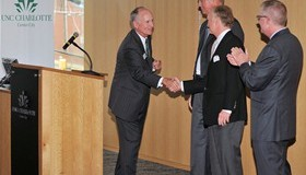 UNC Charlotte Chancellor Philip Dubois and Dean Steven Ott, far right, thank Fred Klein, center left, and Don Childress on Sept. 23 for a $2.5 million gift to UNC Charlotte. Photo courtesy Wade Bruton/UNC Charlotte