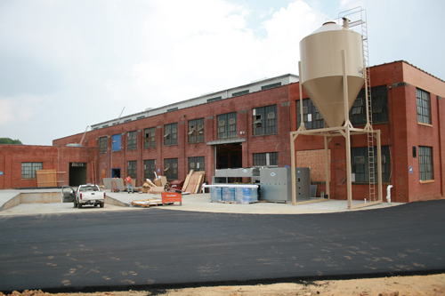 NoDa Brewing Co.'s new location on North Tryon Street will dramatically increase the company's production capacity. The new brewery is scheduled to open Oct. 1.
