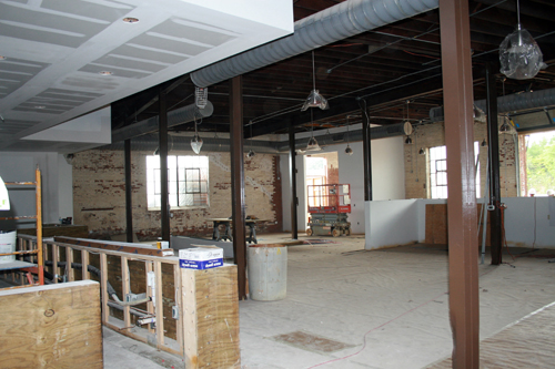 NoDa Brewing Co.'s new tap room will have a large bar and it will be adjacent to a patio with outdoor seating and a service window for customers to order drinks. There will also be food trucks parked nearby.