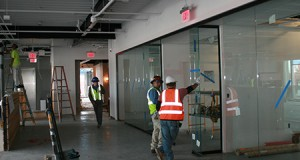 JE Dunn Construction's new office at 1616 Camden Road will be open with lots of glass walls, including on its meeting rooms.  The company expects to finished the work in mid-December. Photo by Mark Abramson