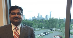 Ebenezer Gujjarlapudi, head of the county's Land Use and Environmental Services Agency, has a view of Charlotte's skyline from his office on Suttle Avenue. He's charged with oversight of code enforcement inspections for residential and commercial construction and his inspectors are busy keeping track of the local building boom. They conduct 1,000 inspections each day.  Photo by David Dykes