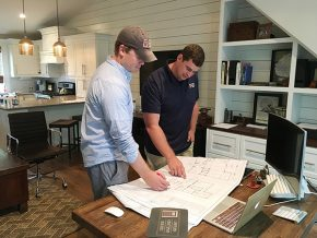 Ryan Meeuwsen and partner Clifton Reasor review plans at the CCB offices, located right behind the home at 445 Louise Ave., Charlotte. Photo by Scott Baughman