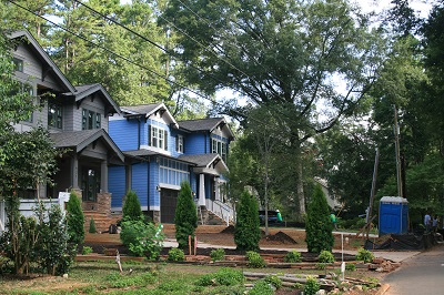 Property on Wonderwood Drive, an established neighborhood of large lots and mature trees off Randolph Road, is being redeveloped using city incentives that permit smaller lots in exchange for tree saving. Photo by Sharon Roberts