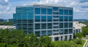The Class A, 10-story Woodward Building was built in 2011 and totals 284,212 square feet. The LEED Gold Certified building includes a two-story lobby and all-glass exterior curtain walls. Photo courtesy Cushman & Wakefield